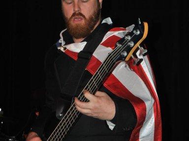 Aric wearing American flag cape